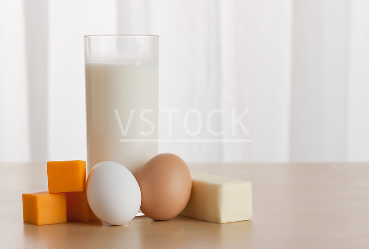 USA, Illinois, Metamora, Eggs and cheese beside glass of milk