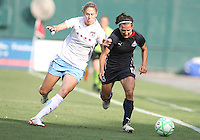 Lisa De Vanna #17 of the Washington Freedom is challenged by Marion Dalmy #2 of the Chicago Red Stars during a WPS match at RFK stadium on June 13 2009 in Washington D.C. The game ended in a 0-0 tie.