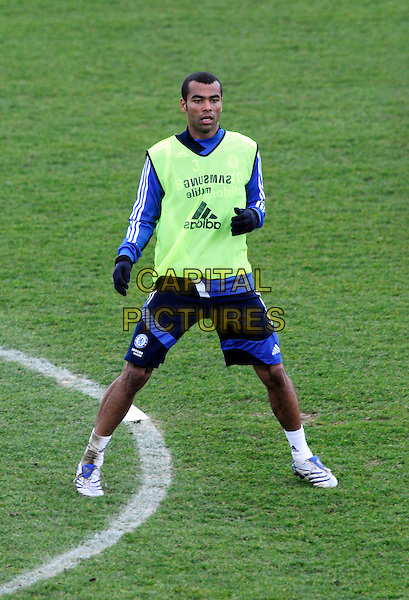ASHLEY COLE.At Chelsea training ground, Cobham, Surrey, England..March 14th, 2008.full length sport football soccer kit uniform blue short fluorescent vest top .CAP/DH.©David Hitchens/Capital Pictures.