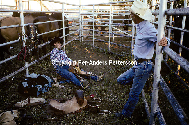 Two unidentified rodeo contestants prepare for a rodeo event on July 13, 1998 in Brownsville, Texas, USA. They are attended a yearly rodeo held at a local stadium. Rodeo is on of the most popular pastimes in this area. (Photo by: Per-Anders Pettersson).