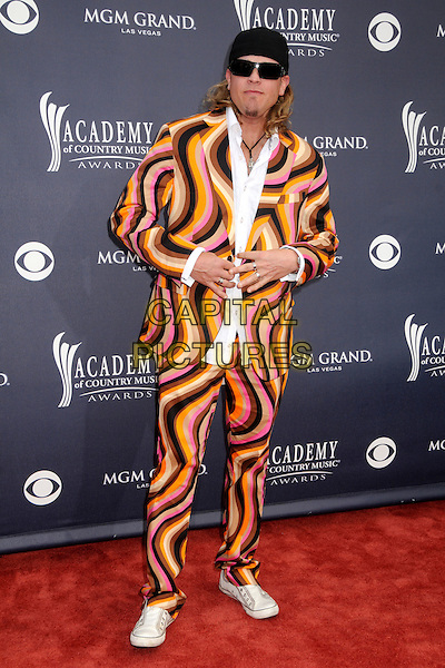 IRA DEAN .46th Annual Academy of Country Music Awards - Arrivals held at the MGM Grand Garden Arena, Las Vegas, Nevada, USA, 3rd April 2011..full length  hat cap sunglasses white shirt pink yellow patterned jacket brown print  trainers converse .CAP/ADM/BP.©Byron Purvis/AdMedia/Capital Pictures.