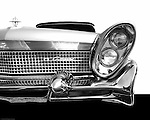 1958 Lincoln Continental. This land yacht happened to be a hard top convertible. The design of the cars in the late 1950's were all about accessories & sparkle - this car seemed to meet the definition perfectly.