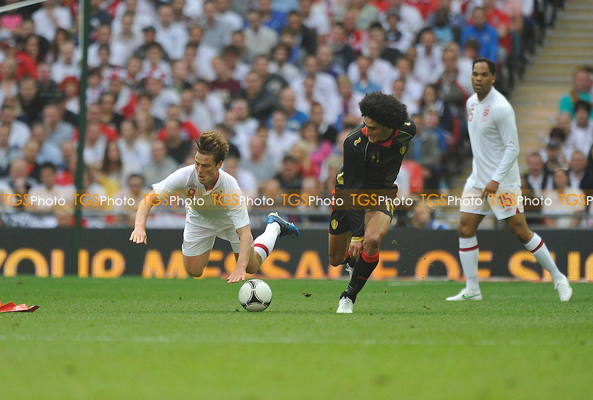 Scott Parker of England and Marouane Fellaini of Belgium - England vs Belgium - International Football Friendly Match at Wembley Stadium, London -02/06/2012 - MANDATORY CREDIT: Martin Dalton/TGSPHOTO - Self billing applies where appropriate - 0845 094 6026 - contact@tgsphoto.co.uk - NO UNPAID USE.