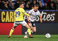 Bolton Wanderers' Pawel Olkowski competing with Blackburn Rovers' Corry Evans<br /> <br /> Photographer Andrew Kearns/CameraSport<br /> <br /> The EFL Sky Bet Championship - Bolton Wanderers v Blackburn Rovers - Saturday 6th October 2018 - University of Bolton Stadium - Bolton<br /> <br /> World Copyright &copy; 2018 CameraSport. All rights reserved. 43 Linden Ave. Countesthorpe. Leicester. England. LE8 5PG - Tel: +44 (0) 116 277 4147 - admin@camerasport.com - www.camerasport.com