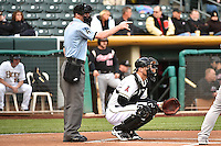 Home plate umpire Scott Mahoney (4) and John Hester (22) of the Salt Lake Bees during the game against the Sacramento River Cats at Smith's Ballpark on April 3, 2014 in Salt Lake City, Utah.  (Stephen Smith/Four Seam Images)
