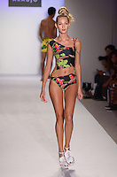 Francis Martins walks runway at A.Z Araujo Swimwear Show during Mercedes Benz IMG Fashion Swim Week 2013 at The Raleigh Hotel, Miami Beach, FL on July 23, 2012
