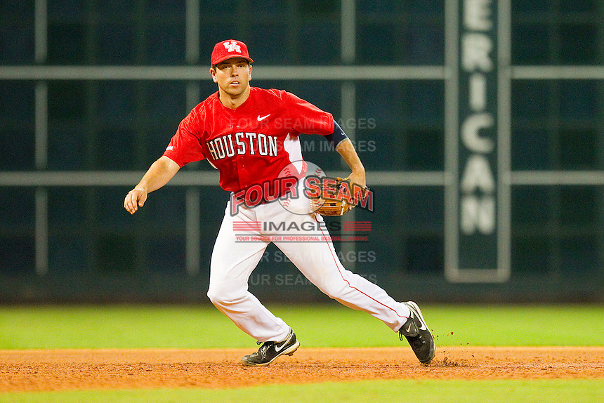 Third baseman Travis Trial #27 of the Houston Cougars on defense against the Texas A&M Aggies at Minute Maid Park on March 6, 2011 in Houston, Texas.  Photo by Brian Westerholt / Four Seam Images