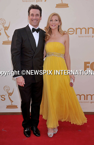 """JENNIFER WESTFELDT AND JON HAMM.attends the Academy of Television Arts & Sciences 63rd Primetime Emmy Awards at Nokia Theatre L.A. Live, Los Angeles_18/09/2011.Mandatory Photo Credit: ©Crosby/Newspix International. .**ALL FEES PAYABLE TO: """"NEWSPIX INTERNATIONAL""""**..PHOTO CREDIT MANDATORY!!: NEWSPIX INTERNATIONAL(Failure to credit will incur a surcharge of 100% of reproduction fees).IMMEDIATE CONFIRMATION OF USAGE REQUIRED:.Newspix International, 31 Chinnery Hill, Bishop's Stortford, ENGLAND CM23 3PS.Tel:+441279 324672  ; Fax: +441279656877.Mobile:  0777568 1153.e-mail: info@newspixinternational.co.uk"""