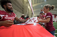 NWA Democrat-Gazette/J.T. WAMPLER Brooklyn Quinn, 7, gets an autograph from Hog football player Jared Cornelius Saturday August 12, 2017 during the RazorbacksÕ annual Fan Day at the University of Arkansas. Football players and coaches were available for autographs with the soccer and volleyball teams.