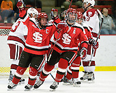 Travis Vermeulen (St. Lawrence - 26), Alex Curran (St. Lawrence - 17) celebrate George Hughes' goal which made it 1-0 SLU. - The St. Lawrence University Saints defeated the Harvard University Crimson 3-2 on Friday, November 20, 2009, at the Bright Hockey Center in Cambridge, Massachusetts.
