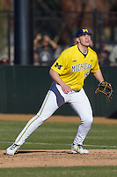 Michigan Wolverines first baseman Kendall Patrick (15) on defense during the NCAA season opening baseball game against the Texas State Bobcats on February 14, 2014 at Bobcat Ballpark in San Marcos, Texas. Texas State defeated Michigan 8-7 in 10 innings. (Andrew Woolley/Four Seam Images)