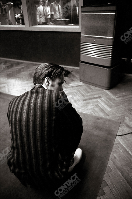 """At a session in Studio 1 RCA, when Elvis recorded """"Hound Dog"""" and """"Don't Be Cruel"""". He is listening to the playback in front of the speaker. Manhattan, New York City, USA, July 2 middle of afternoon, 1956"""