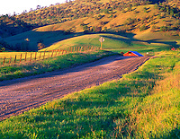 Road, barn and farmland. Near Williams, California