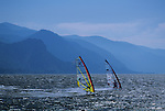 Two windsurfers on the Columbia River near Hood River, Oregon State, photographed from the Washington side looking west, blue skies, Washington State USA
