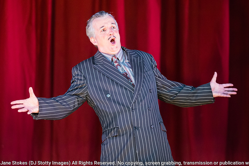 Dress rehearsal of The Sorcerer performed by the National Gilbert &amp; Sullivan Opera Company with the National Festival Orchestra in Buxton Opera House, Buxton, England on Saturday 04 August 2018 Photo: Jane Stokes<br /> <br /> Director: John Savournin<br /> Conductor: James Hendry<br /> Choreographer: Damian Czarnecki<br /> <br /> CAST<br /> <br /> SIR MARMADUKE POINTDEXTRE/Eddie Wade<br /> ALEXIS/Nick Sales<br /> DR DALY/Matthew Kellett<br /> NOTARY/Stephen Godward<br /> JOHN WELLINGTON WELLS/ Richard Gauntlett<br /> LADY SANGAZURE/Mae Hendorn<br /> ALINE/Ellen Williams<br /> MRS PARTLET/Ros Griffiths<br /> CONSTANCE/Emma Watkinson<br /> <br /> THE CHORUS<br /> <br /> Hannah Boxall, Nicole Boardman, Rhiannon Doogan, Joanna Goldspink, Alexandra Hazard, Maisy Hepburn, Juliet Montgomery, Jennifer Parker, Julie Power, Stephanie Poropat, Eloise Waterhouse<br /> <br /> Andrew Brown, Tom Blackwell, Peter Brooks, Stephen Fawell, Matthew Kellett, Michael Vincent Jones, Matthew Siveter, Henry Smith, Jonathan Stevens, Tim Southgate<br /> <br /> PRODUCTION TEAM<br /> <br /> TOUR MANAGER/Neil Smith<br /> STAGE MANAGER/Sarah Kent<br /> ASSISTANT STAGE MANAGER/Claire Litton<br /> LIGHTING DESIGN/David Marsden<br /> WARDROBE SUPERVISOR/ David Morgan<br /> SET DESIGN/ Paul Lazell<br /> REPETITEUR/Erica Gundesen