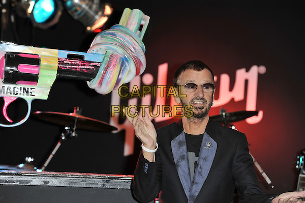Ringo Starr.Unveiling of the 'Knotted Gun' statue for the Non Violence Foundation, Gibson Guitar Studio, London, England. .8th December 2011.half length black suit sunglasses shades beard facial hair hand mouth open.CAP/MAR.© Martin Harris/Capital Pictures.