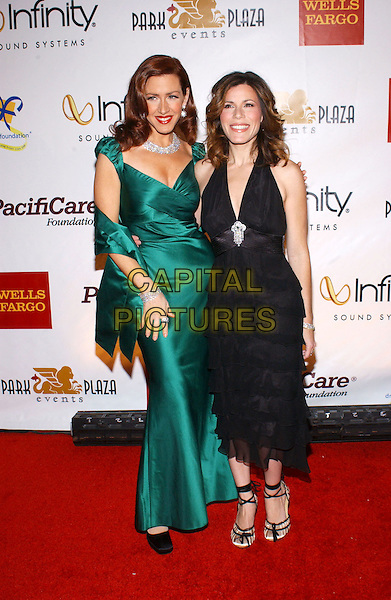 JOELY & TRISHA FISHER.3rd Annual Cabaret of Dreams to benefit the Dream Foundation held at the Park Plaza Hotel..November 4th, 2004.full length, black dress, ruffles layers, black skirt, strappy sandals, green silk satin dress, sisters, siblings.www.capitalpictures.com.sales@capitalpictures.com.© Capital Pictures.