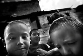 Wroclaw 12.08.2006 Poland<br /> The worst and the most dangerous district in Wroclaw ( Poland ) , called by people &quot;The Bermuda Triangle&quot;. There are walls bearing an inscription &quot;Who will enter here, will not exit alive&quot; Many families there are pathological and live in extreme poverty. Children have no place for any games so they loaf around on this wasted district and disseminate a juvenile delinquency. Many of them become sexually active though they are only 10-12 years old<br /> (Photo by Adam Lach / Napo Images)<br /> <br /> Najbardziej nabezpieczna dzielnica we Wroclawiu zwana przez ludzi Trojkatem Bermudzkim. Sa tam sciany opatrzone napisem &quot; Kto tu wejdzie, nigdy nie wyjdzie stad zywy&quot; Mieszka tam wiele rodzin patologicznych i zyja w wielkiej nedzy. Dzieci wlocza sie po ulicach nie majac miejsc na zabawe i szerza przestepczosc wsrod nieletnich. Wiele z dzieci uprawia seks choc maja zaledwie 10-12 lat<br /> (Fot Adam Lach / Napo Images)
