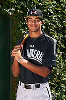 Infielder Jacob Gatewood (13) of Redwood High School in Visalia, California poses for a photo before the Under Armour All-American Game on August 24, 2013 at Wrigley Field in Chicago, Illinois.  (Mike Janes/Four Seam Images)