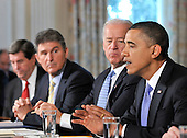 Washington, D.C. - January 4, 2010 -- United States President Barack Obama and Vice President Joseph Biden meet with a bipartisan group of Governors from across the country in the State Dining Room to discuss energy policy in Washington, D.C. on Wednesday, February 3, 2010.  From left to right: Governor Bob Riley (Republican of Alabama), Chairman, Southern Governors Association; Governor Joe Manchin (Democrat of West Virginia), Vice Chairman, National Governors Association (NGA); Vice President Biden; President Obama..Credit: Ron Sachs / Pool via CNP
