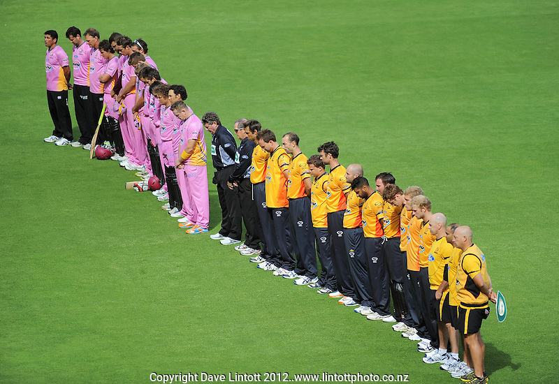 The teams bow their heads for a moments silence in tribute to the victims of the Carterton ballooning tragedy during the HRV Cup Twenty20 cricket match between Wellington Firebirds v Northern Knights at Hawkins Finance Basin Reserve, Wellington. Wednesday, 11 January 2012. Photo: Dave Lintott / lintottphoto.co.nz