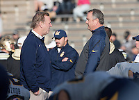 California Offensive Coordinator Tony Franklin talks with California head coach Sonny Dykes before the game against Colorado at Folsom Field in Boulder, Colorado on November 16th, 2013.  Colorado defeated California, 41-24.