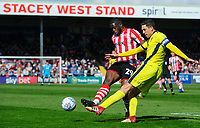 Cheltenham Town's Ben Tozer under pressure from Lincoln City's John Akinde<br /> <br /> Photographer Chris Vaughan/CameraSport<br /> <br /> The EFL Sky Bet League Two - Lincoln City v Cheltenham Town - Saturday 13th April 2019 - Sincil Bank - Lincoln<br /> <br /> World Copyright © 2019 CameraSport. All rights reserved. 43 Linden Ave. Countesthorpe. Leicester. England. LE8 5PG - Tel: +44 (0) 116 277 4147 - admin@camerasport.com - www.camerasport.com