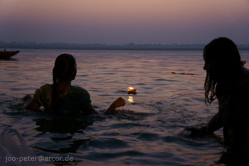 Early morning prayer (puja)in the water of river Ganga in Varanasi