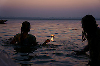 Early morning prayer (puja)in the water of river Ganga in Varanasi