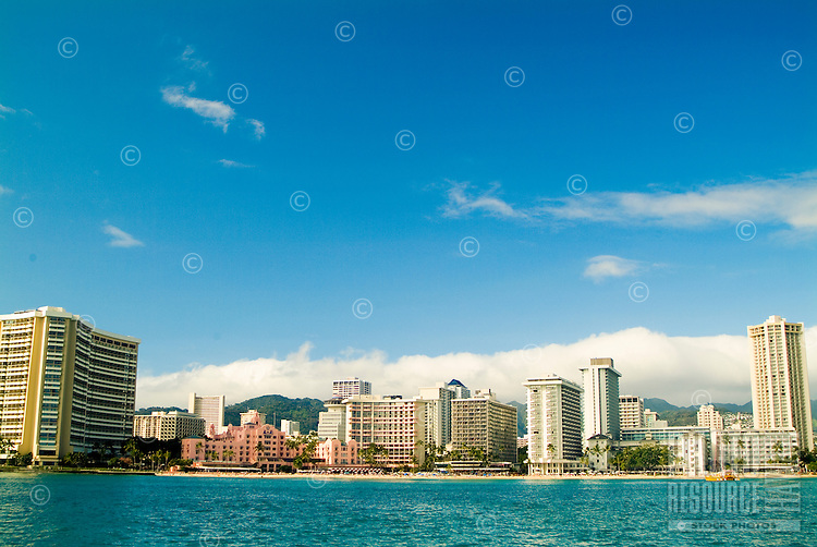 The famous coastline of Waikiki Beach shot from a sailboat.