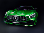 Stylized photo illustration of Green 2017 Mercedes-Benz AMG GT R Coupe sports car isolated on black background Image © MaximImages, License at https://www.maximimages.com