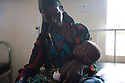 Kenya - Dadaab - A Somali refugee taking care of her malnourished child being treated at the hospital.