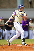 Jacob Hoyle (27) of the Western Carolina Catamounts follows through on his swing against the Davidson Wildcats at Wilson Field on March 10, 2013 in Davidson, North Carolina.  The Catamounts defeated the Wildcats 5-2.  (Brian Westerholt/Four Seam Images)