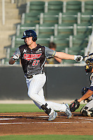 Adam Engel (23) of the Kannapolis Intimidators follows through on his swing against the Asheville Tourists at CMC-NorthEast Stadium on July 12, 2014 in Kannapolis, North Carolina.  The Tourists defeated the Intimidators 7-5 in 15 innings.  (Brian Westerholt/Four Seam Images)