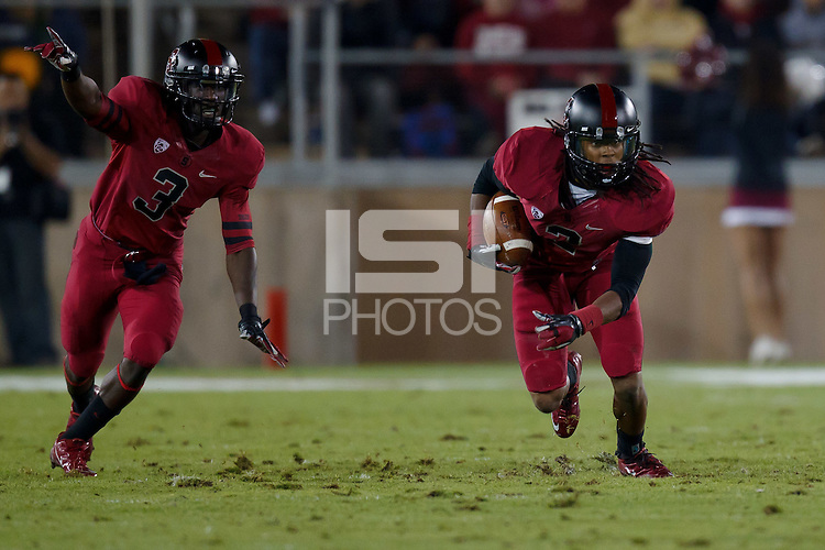 STANFORD, CA - November 26, 2011: Wayne Lyons and Michael Thomas on an interception during Stanford's 28-14 win over Notre Dame at Stanford Stadium.