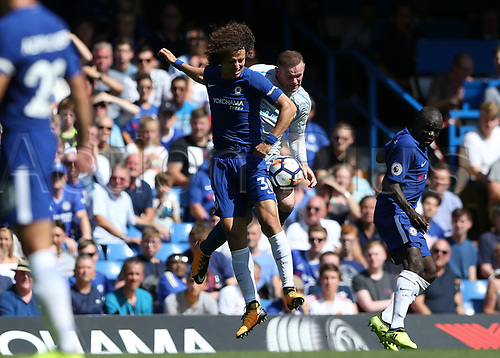 27th August 2017, Stamford Bridge, London, England; EPL Premier League football, Chelsea versus Everton; David Luiz of Chelsea and Wayne Rooney of Everton both compete for the ball mid air