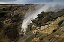 11/01/15<br /> <br /> Two hikers brave walking in the spray above Kinder Downfall as the 30 metre waterfall is blown back up on to the Kinder Plateau as 65mph gusts of wind batter the Derbyshire Peak District near Hayfield.<br /> <br /> All Rights Reserved - F Stop Press. www.fstoppress.com. Tel: +44 (0)1335 300098