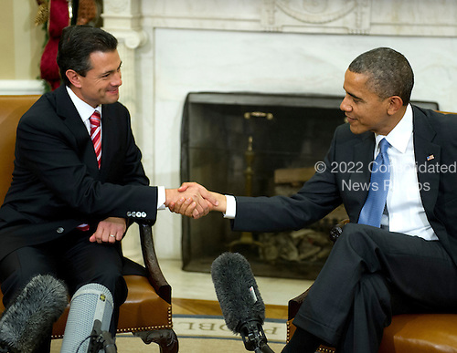 United States President Barack Obama, right, shakes hands with President-elect Enrique Peña Nieto of Mexico after making remarks to the press in the Oval Office of White House in Washington, DC on Tuesday, November 27, 2012..Credit: Ron Sachs / Pool via CNP