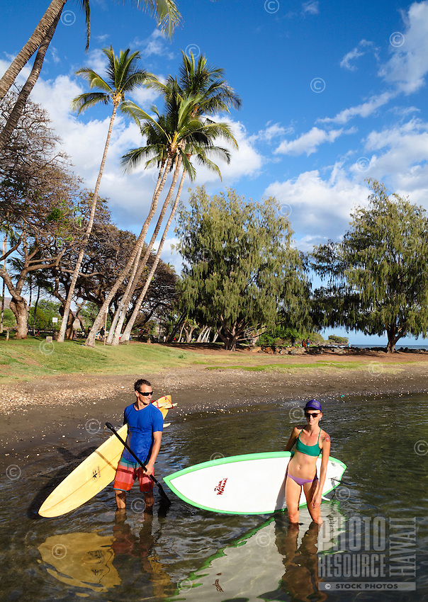A couple enters at Launiupoko State Wayside Park, Maui.