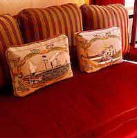 Detail of a pair of woven cushion covers on the library sofa depicting old scenes of Istanbul