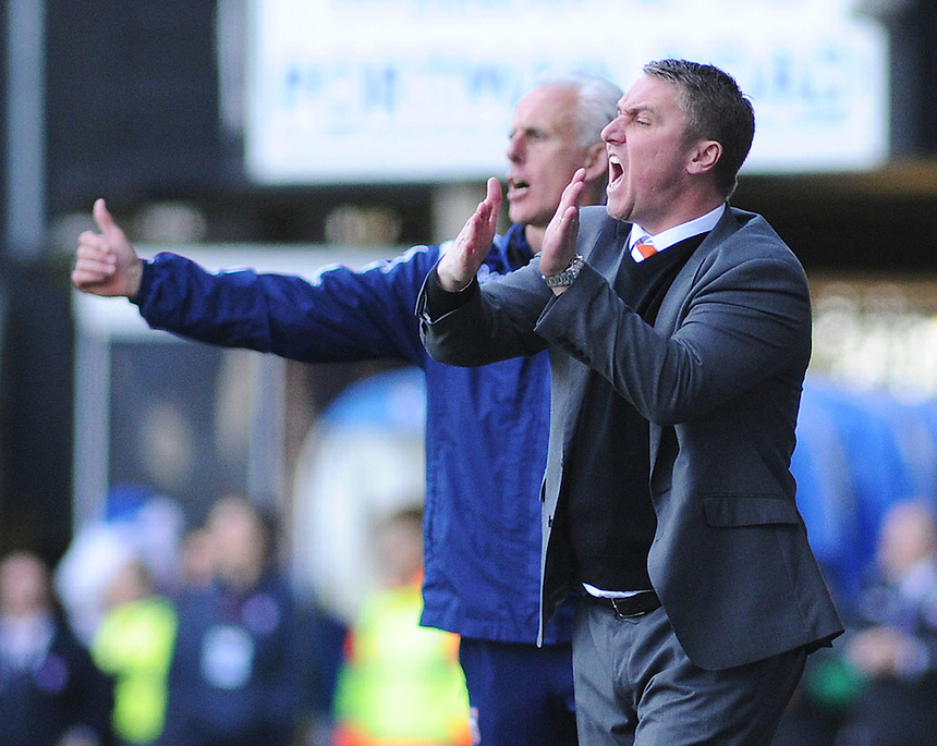 Blackpool Manager Lee Clark shouts instructions to his team from the dug-out<br /> <br /> Photographer Kevin Barnes/CameraSport<br /> <br /> Football - The Football League Sky Bet Championship - Ipswich Town v  Blackpool - Saturday 11th April 2015 - Portman Road - Ipswich<br /> <br /> &copy; CameraSport - 43 Linden Ave. Countesthorpe. Leicester. England. LE8 5PG - Tel: +44 (0) 116 277 4147 - admin@camerasport.com - www.camerasport.com