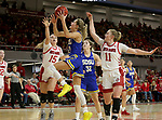 VERMILLION, SD - JANUARY 19: Tylee Irwin #21 of the South Dakota State Jackrabbits takes the ball to the basket past Taylor Frederick #15 and Monica Arens #11 of the South Dakota Coyotes at the Sanford Coyote Center on January 19, 2020 in Vermillion, South Dakota. (Photo by Dave Eggen/Inertia)