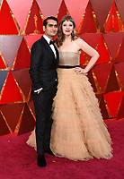Kumail Nanjiani, left, and Emily V. Gordon arrive at the Oscars on Sunday, March 4, 2018, at the Dolby Theatre in Los Angeles. (Photo by Richard Shotwell/Invision/AP)