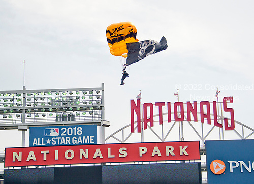 The United States Army Golden Knights Parachute Jump Team puts on an Independence Day show prior to the game pitting the New York Mets against the Washington Nationals at Nationals Park in Washington, D.C. on Tuesday, July 4, 2017.  <br /> Credit: Ron Sachs / CNP<br /> (RESTRICTION: NO New York or New Jersey Newspapers or newspapers within a 75 mile radius of New York City)