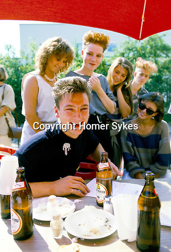 Mark O'Toole from British band 'Frankie Goes to Hollywood' with groupies, filling in form of likes and dislikes for 'Popcorn', TV studies during break in a days shooting. Munich Germany,
