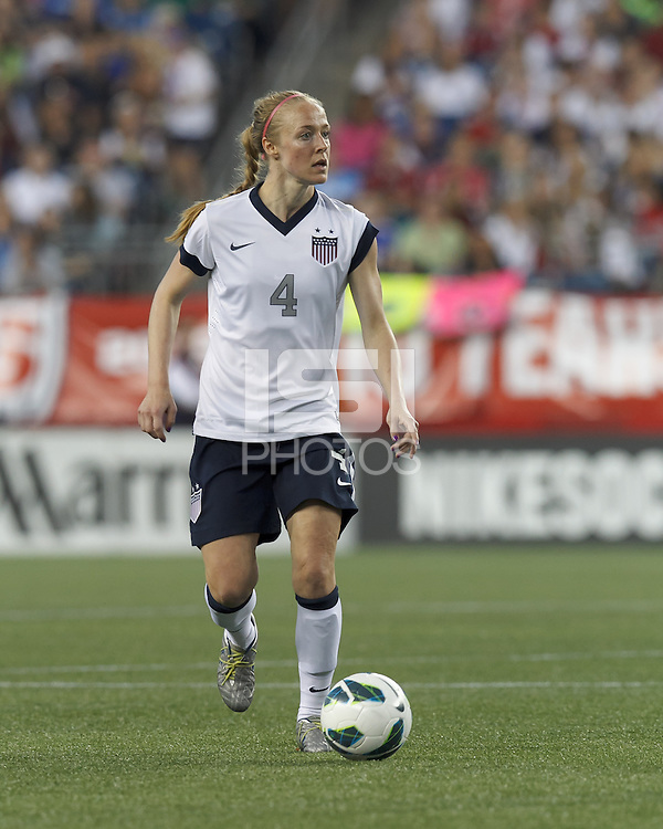 USWNT defender Becky Sauerbrunn  (4) brings the ball forward.  In an international friendly, the U.S. Women's National Team (USWNT) (white/blue) defeated Korea Republic (South Korea) (red/blue), 4-1, at Gillette Stadium on June 15, 2013.