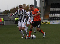 John Rankin watched by Jon Robertson in the St Mirren v Dundee United Clydesdale Bank Scottish Premier League match played at St Mirren Park, Paisley on 27.10.12.