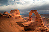 Delicate Arch stands prominent during threatening skies at Arches National Park, Utah