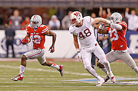 Ohio State Buckeyes cornerback Doran Grant (12) runs back an interception in the third quarter of the Big Ten Championship game at Lucas Oil Stadium in Indianapolis on Saturday, December 6, 2014. (Columbus Dispatch photo by Jonathan Quilter)