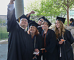 From left, Pedro Ramirez, Lisa duPont Moore, Elliot Drange, Sandra Montgomery and Jenny Hemsath celebrate graduation at the 2015 Western Nevada College Commencement held at the Pony Express Pavilion in Carson City, Nev., on Monday, May 18, 2015.<br /> Photo by Tim Dunn